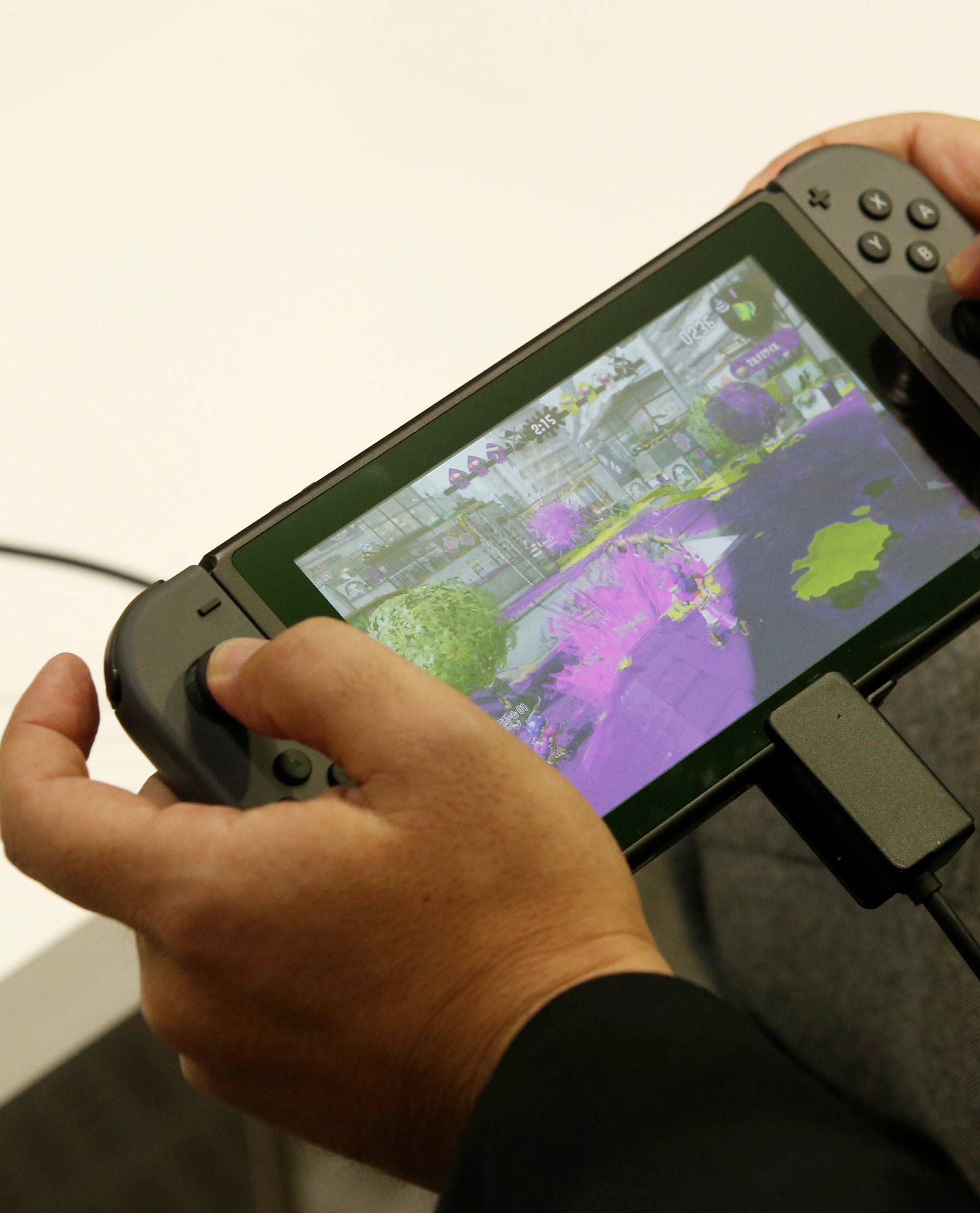 A man plays Nintendo's new game console Switch at its experience venue in Tokyo