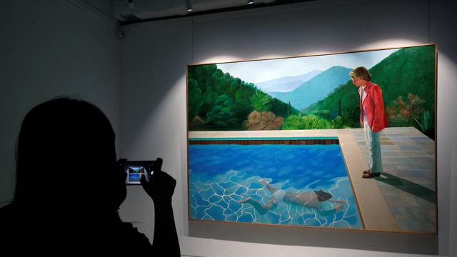 """David Hockney's """"Portrait of an Artist (Pool with Two Figures)"""" is displayed at Christie's preview in Hong Kong"""