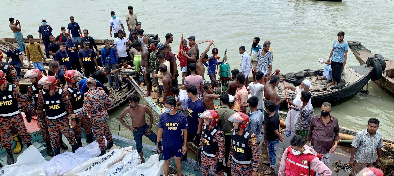 Dead bodies are seen piles up on a boat after a passenger ferry capsized in the river Buriganga in Dhaka