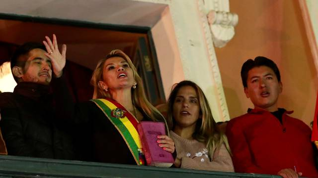 Bolivian Senator Jeanine Anez gestures after she declared herself as Interim President of Bolivia, at the balcony of the Presidential Palace, in La Paz