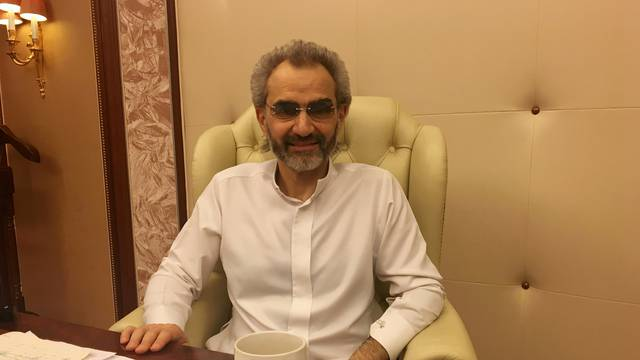 FILE PHOTO: Saudi Arabian billionaire Prince Alwaleed bin Talal sits for an interview with Reuters in the office of the suite where he has been detained at the Ritz-Carlton in Riyadh