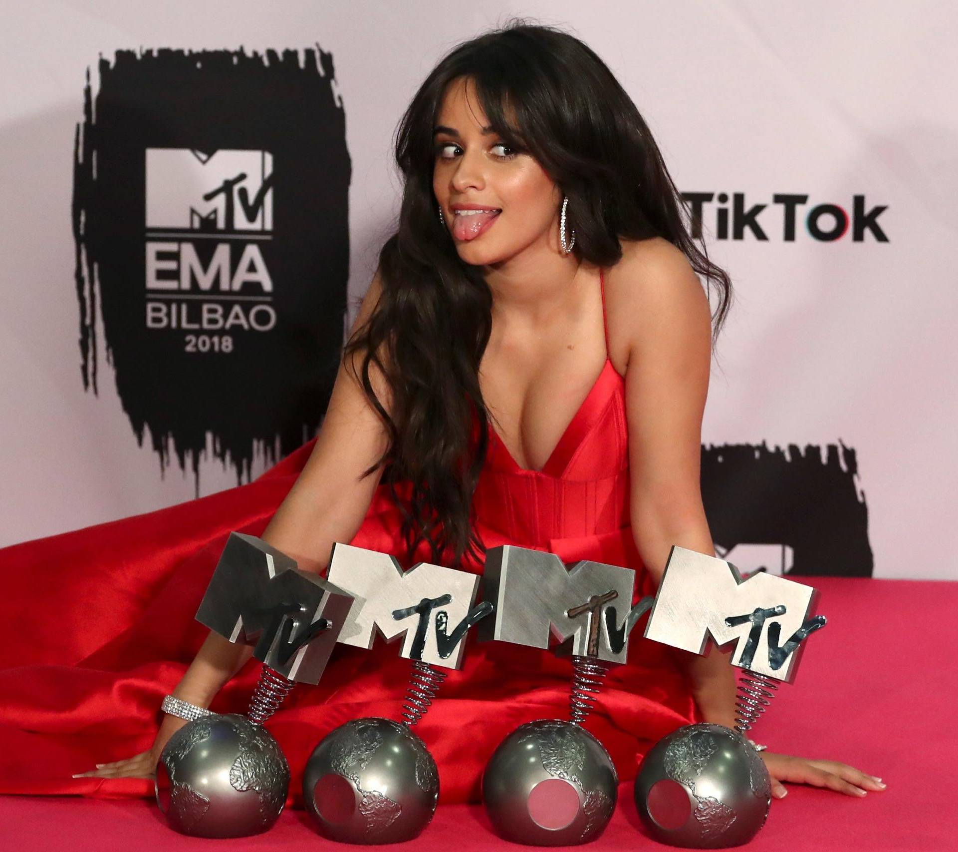 Camila Cabello poses with her awards during the 2018 MTV Europe Music Awards at Bilbao Exhibition Centre in Bilbao