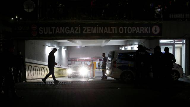 Turkish police officers stand guard outside a car park where a vehicle belonging to Saudi Arabia's consulate was found, in Istanbul