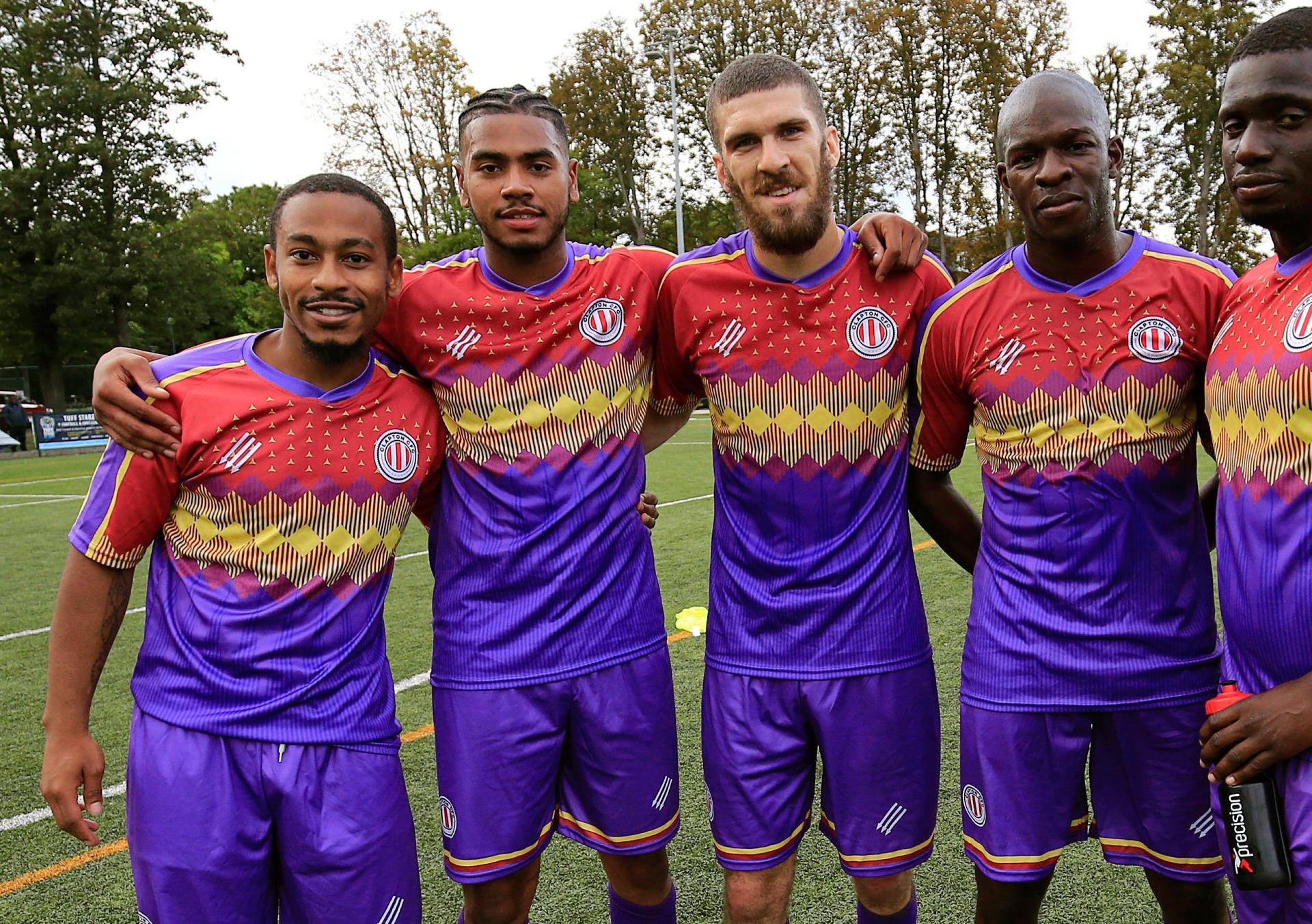 Clapton CFC players pose for pictures after their away game win 2-0 against Healing Town in East Acton, in London