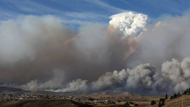 Smoke fills the sky as the East Troublesome Fire burns outside Granby