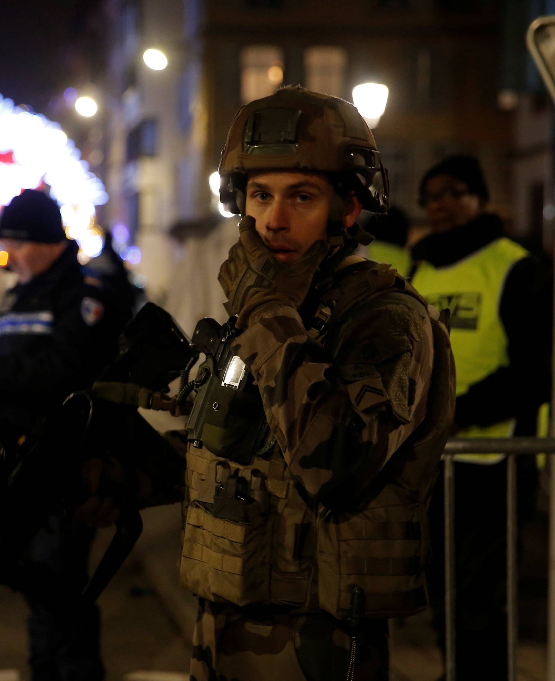 Police officers secure a street and the surrounding area after a shooting in Strasbourg