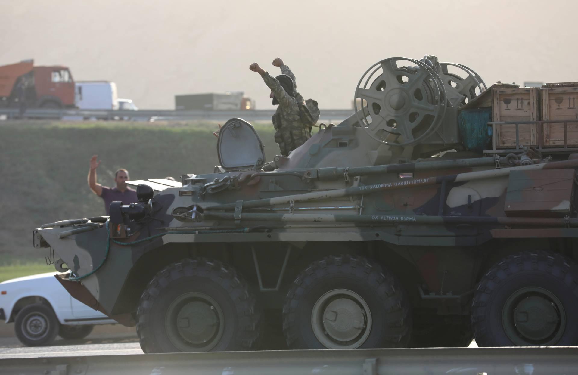 FILE PHOTO: An Azerbaijani service member drives an armoured carrier in Baku