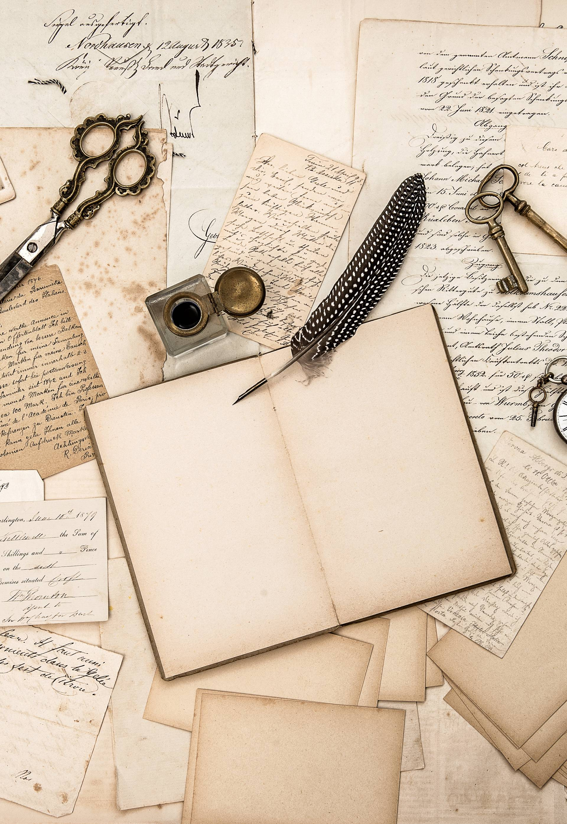 Old handwritten letters, pictures and antique writing accessories