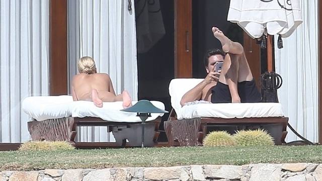 *EXCLUSIVE* Sofia Richie lounges topless with Scott Disick while on vacation