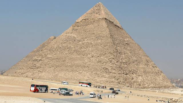 Tourists visit the Giza pyramids area, on the outskirts of Cairo