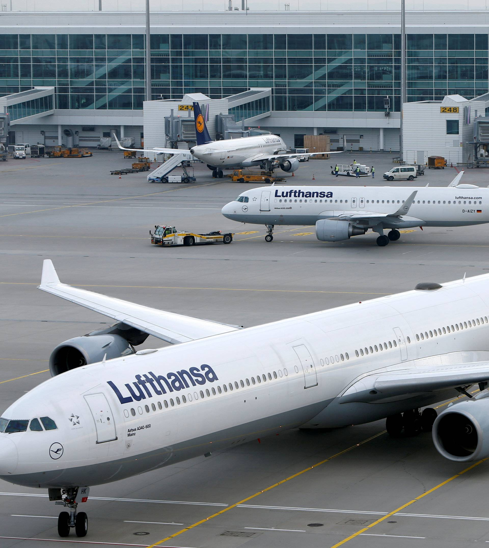 FILE PHOTO: Lufthansa planes arrive at the international airport in Munich