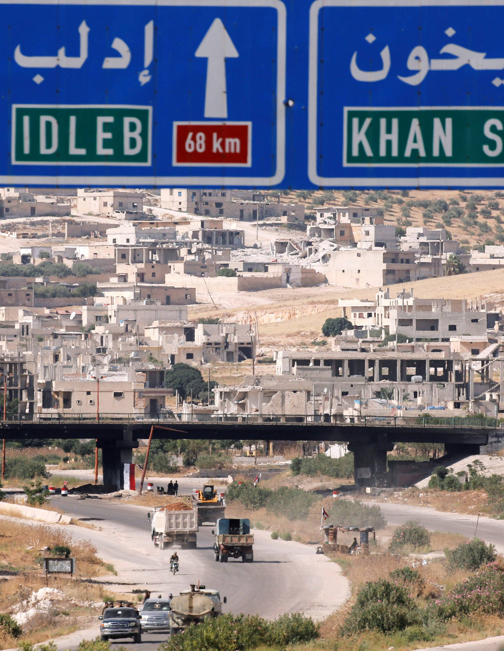 FILE PHOTO: Road direction signs are pictured at the entrance en route to Khan Sheikhoun, Idlib