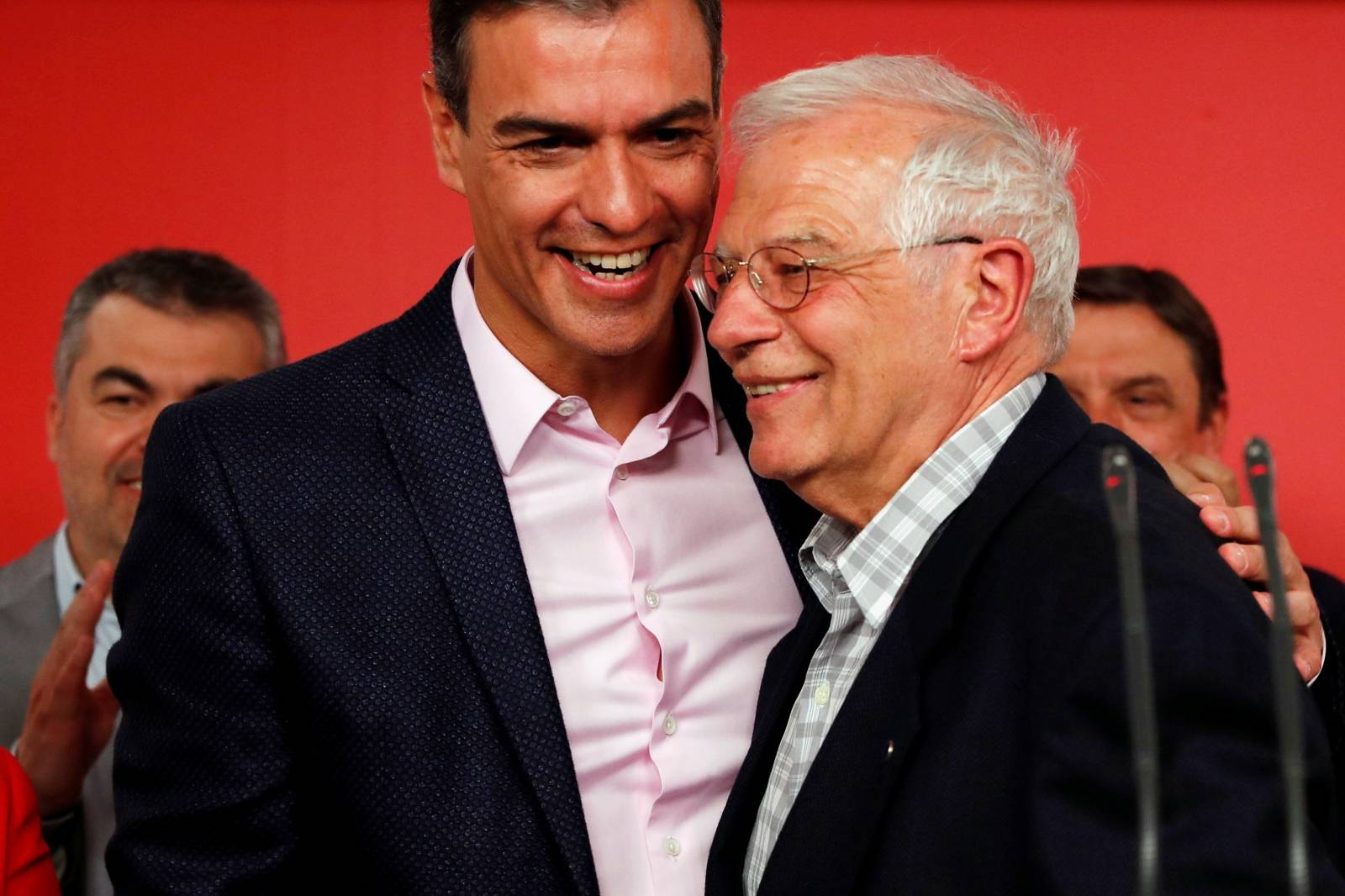 Socialist party (PSOE) candidate for European elections Borrell and Spanish acting PM Sanchez rembrace as they address the media following election results at the party headquarters in Madrid