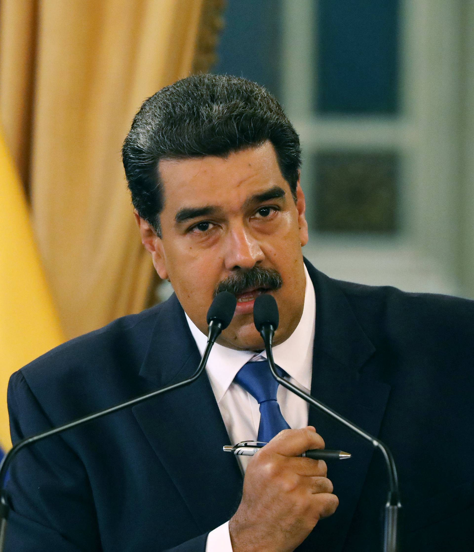 Venezuela's President Nicolas Maduro gestures during a news conference at Miraflores Palace in Caracas