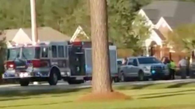 Emergency personnel are seen on site in the aftermath of a shooting in Florence, South Carolina