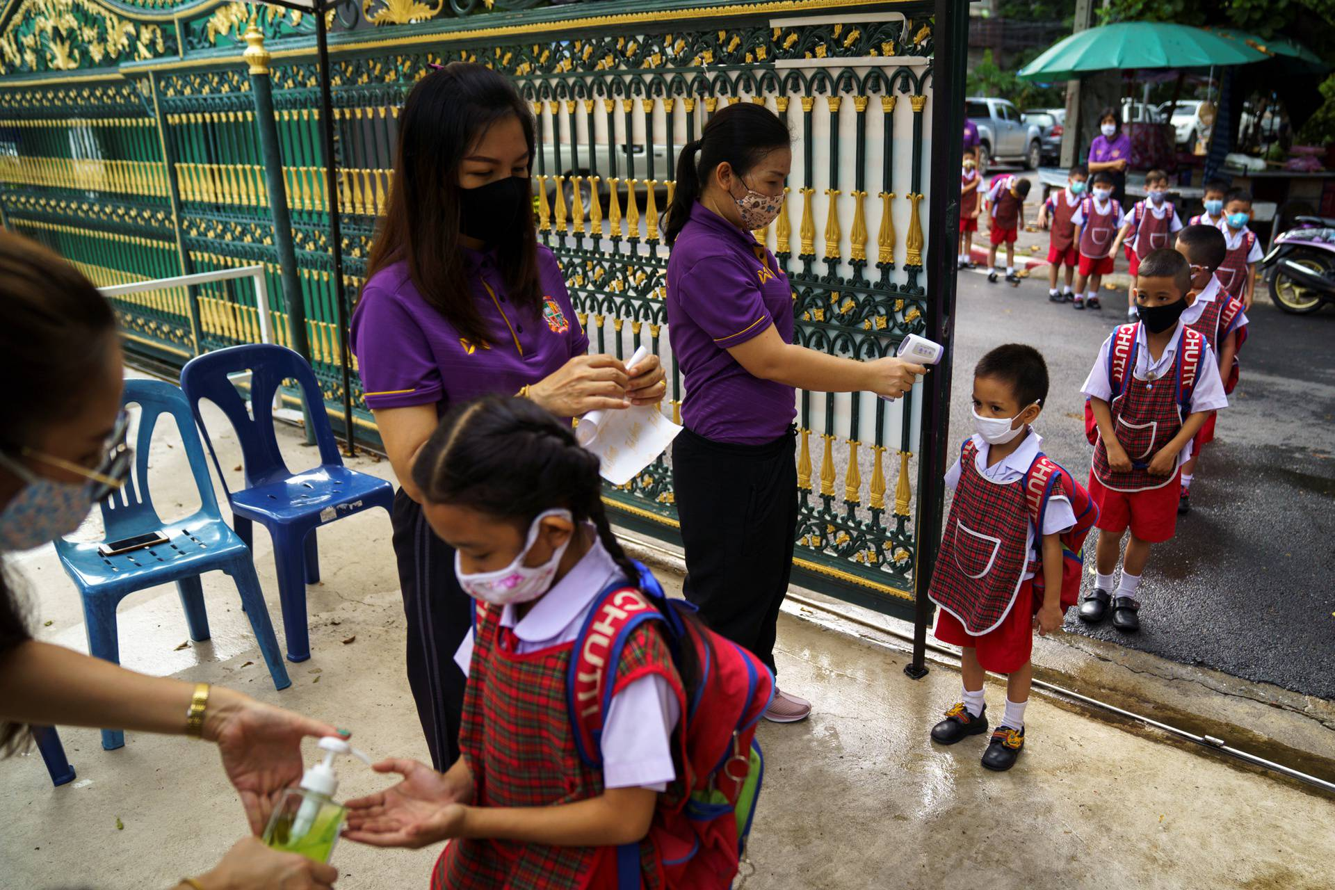 Thai kindergarten students rehearse social distancing and measures to prevent the spread of the coronavirus disease (COVID-19) in Bangkok