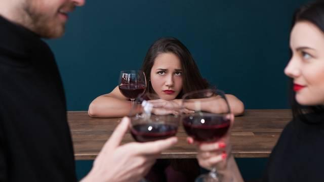 Sad alone female in bar. Jealousy backdrop