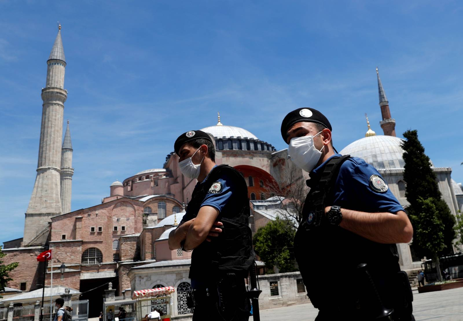 FILE PHOTO: Turkish police officers wearing face masks patrol at touristic Sultanahmet Square in Istanbul