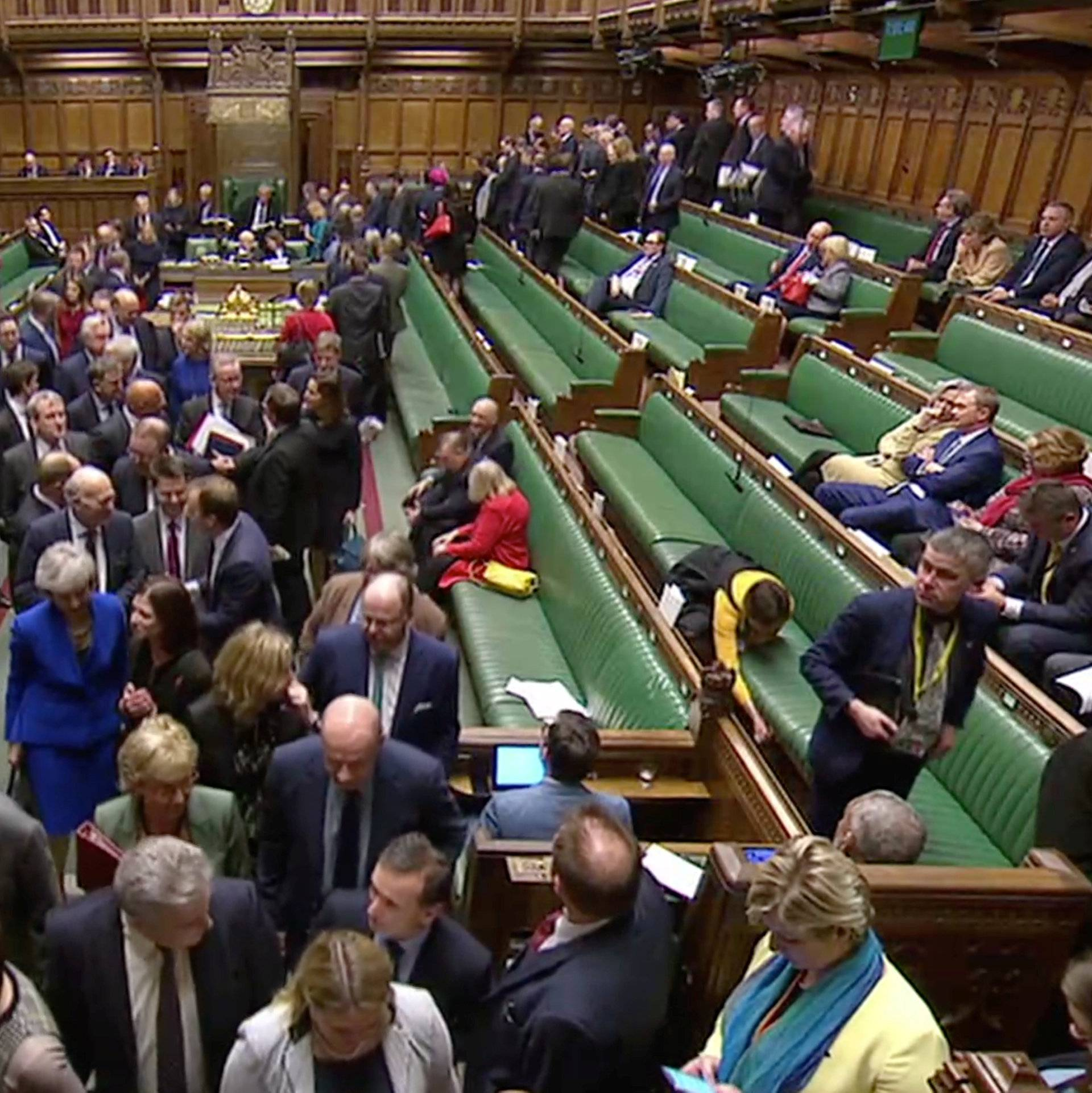 MP's leave the chamber to vote on a motion of no confidence after Parliament rejected Prime Minister Theresa May's Brexit deal, in London