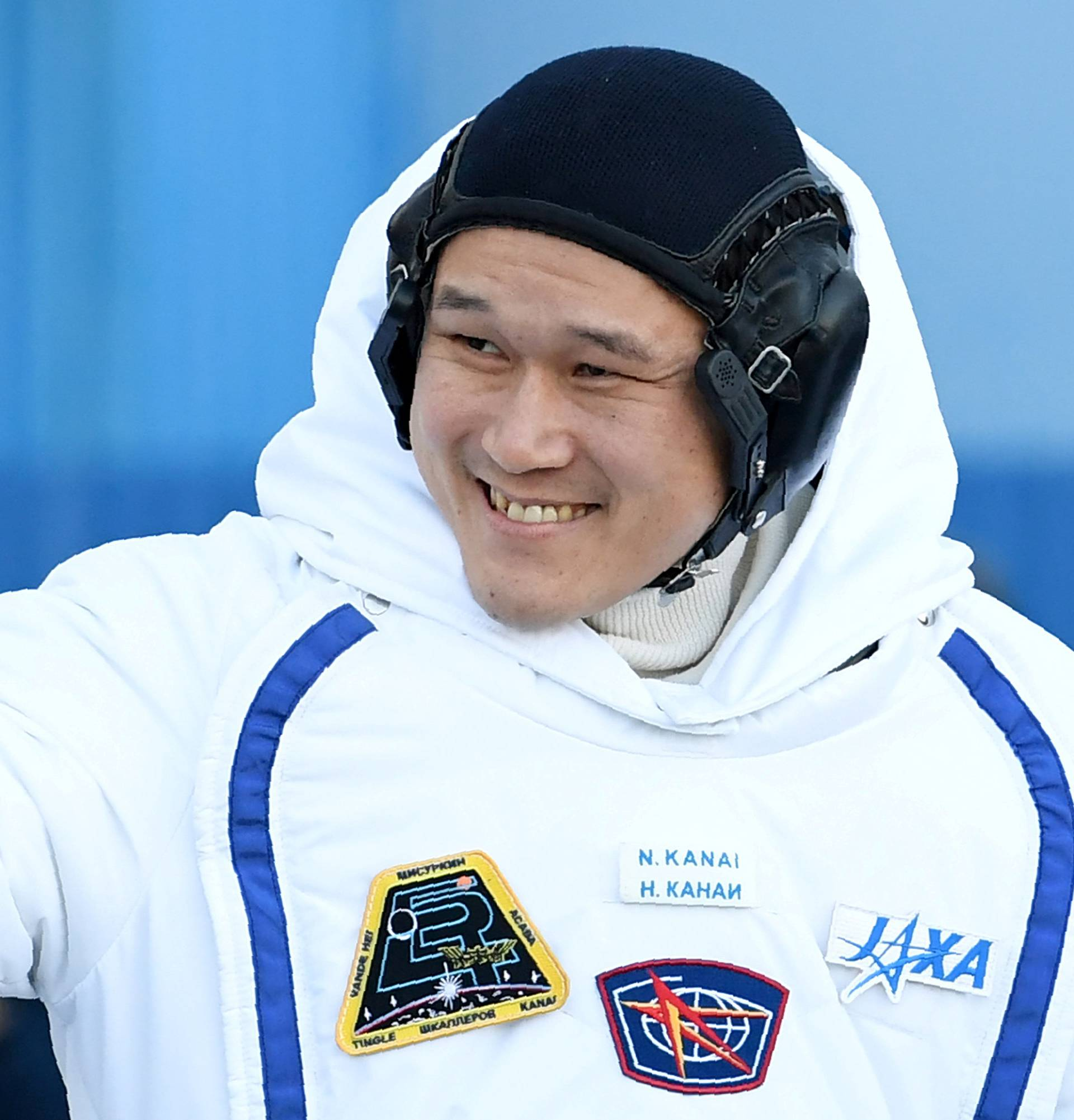 FILE PHOTO: Norishige Kanai of the Japan Aerospace Exploration Agency (JAXA) during the send-off ceremony after checking their space suits before the launch of the Soyuz MS-07 spacecraft at the Baikonur cosmodrome