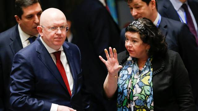 Pierce, UK Ambassador to the United Nations talks with Russian Ambassador to the United Nations Nebenzya before the emergency United Nations Security Council meeting on Syria at the U.N. headquarters in New York