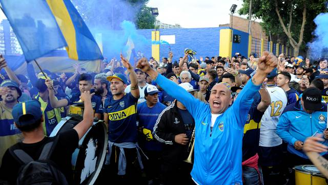 Boca Juniors' fans cheer as their team heads on to Spain to play the Copa Libertadores final, in Buenos Aires