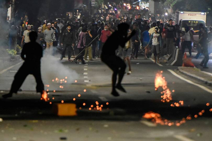 Protesters clash with the police downtown in Thamrin, Jakarta