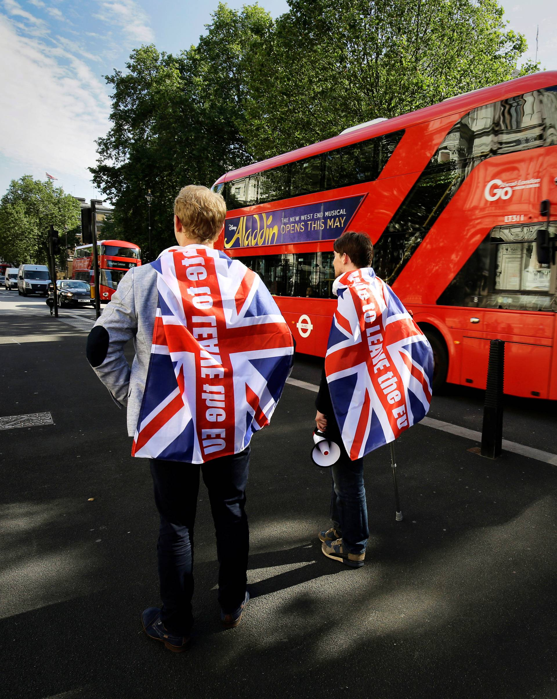 Vote leave supporters stand outside Downing Street in London