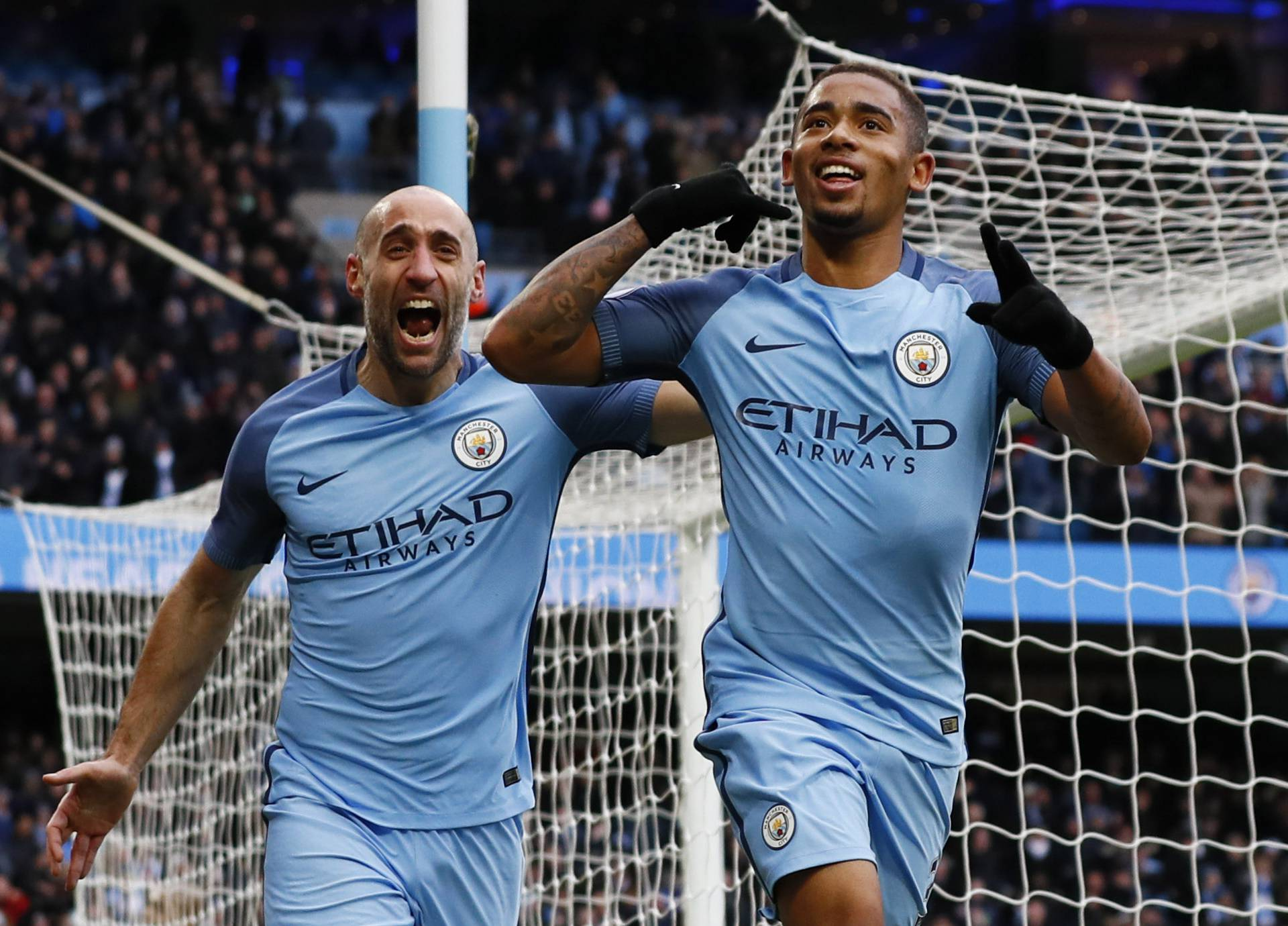 Manchester City's Gabriel Jesus celebrates scoring their second goal with Pablo Zabaleta