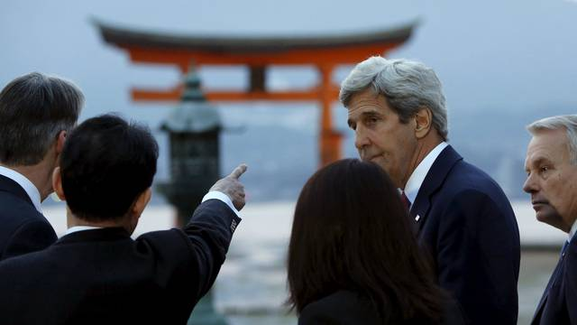 Kerry listens to Kishida as they and G7 foreign ministers visit the Itsukushima Shrine as they take a cultural break from their meetings in nearby Hiroshima to visit Miyajima Island
