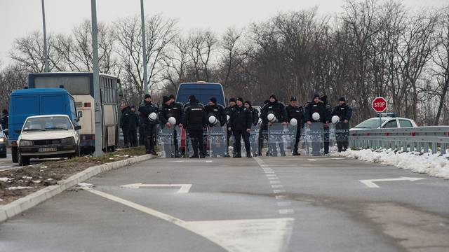 Police guard the road to the Kovilovo sport centre hosting the handball match between Serbia and Kosovo, in Belgrade