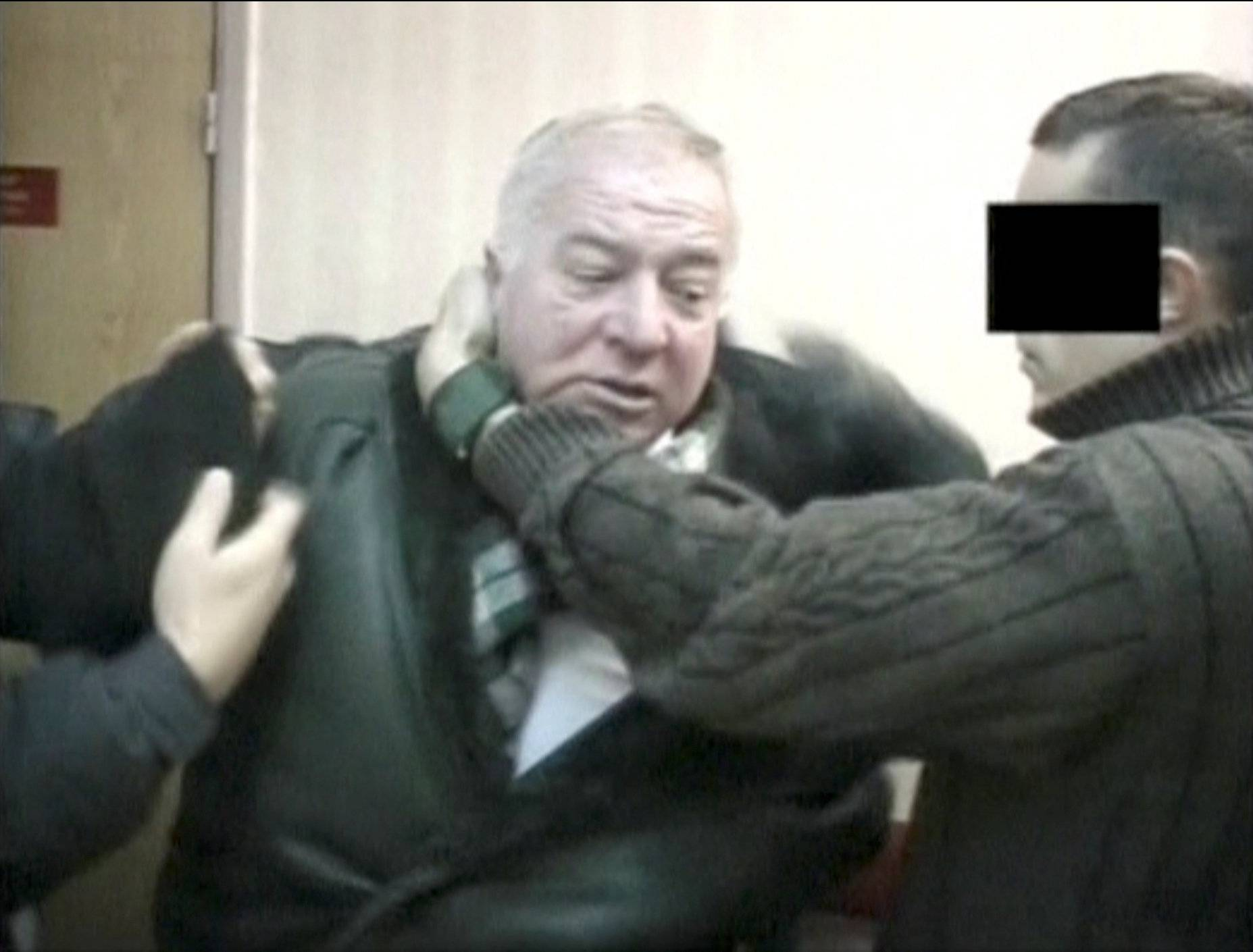 A still image taken from an undated video shows Sergei Skripal, a former colonel of Russia's GRU military intelligence service, being detained by secret service officers in an unknown location.