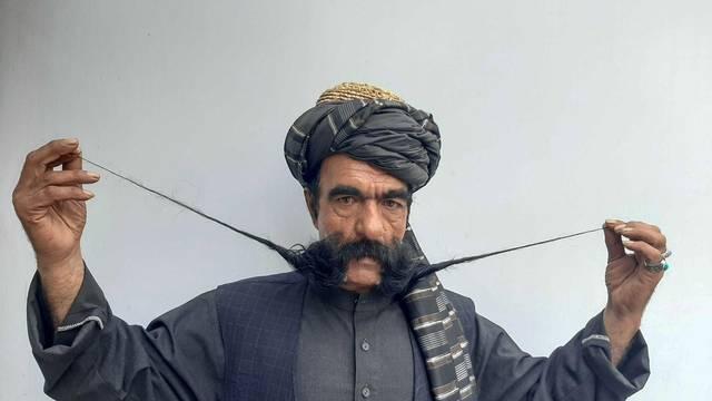 Moustache makes Afghan tailor a celebrity