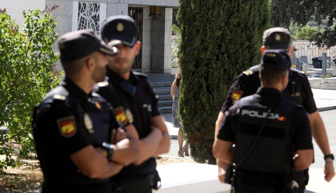 Spanish National Police officers stand near the mausoleum where late dictator Franco is expected to be buried at Mingorrubio-El Pardo cemetery in Madrid