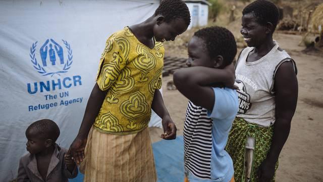 Uganda. South Sudanese refugee Joyce Kidi and her foster children at Bidibidi settlement