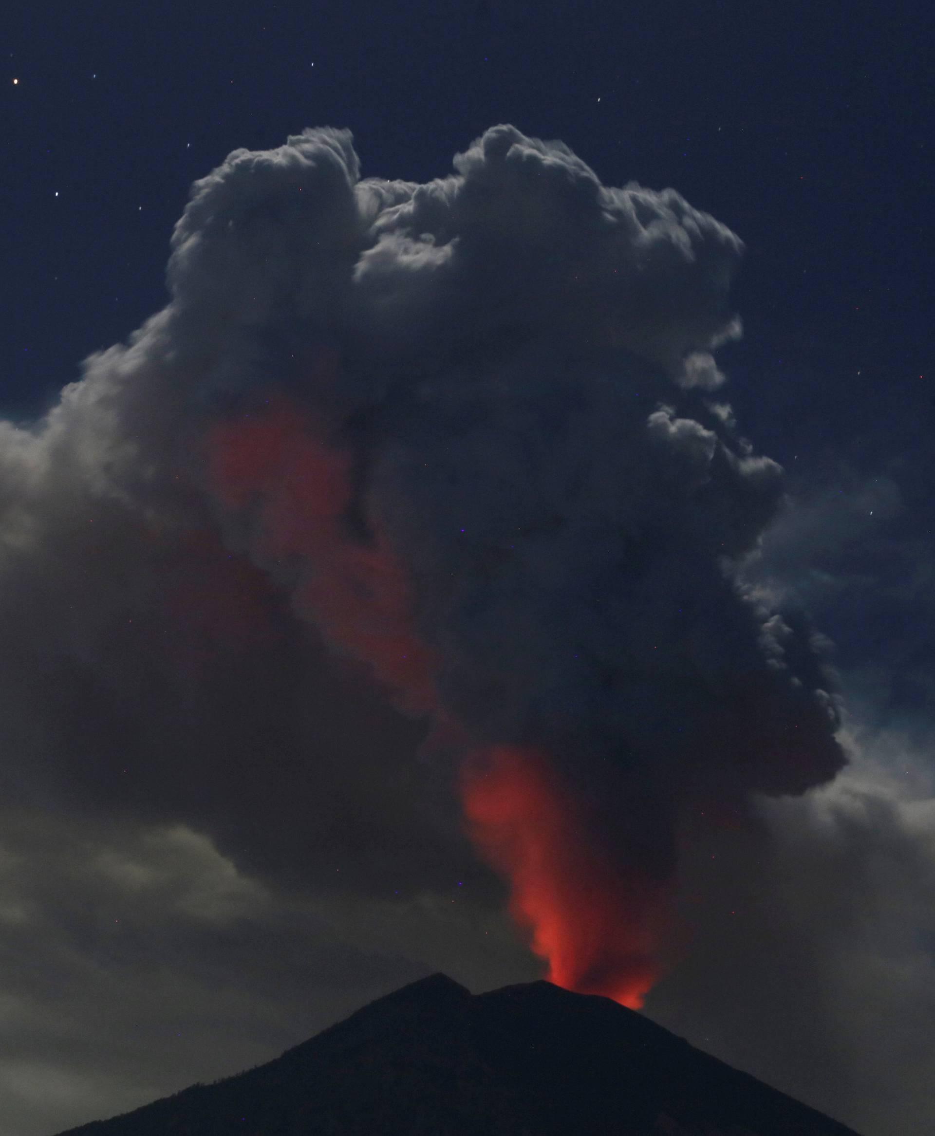 Mount Agung volcano erupts during the night, as seen from Datah village, Karangasem Regency in Bali