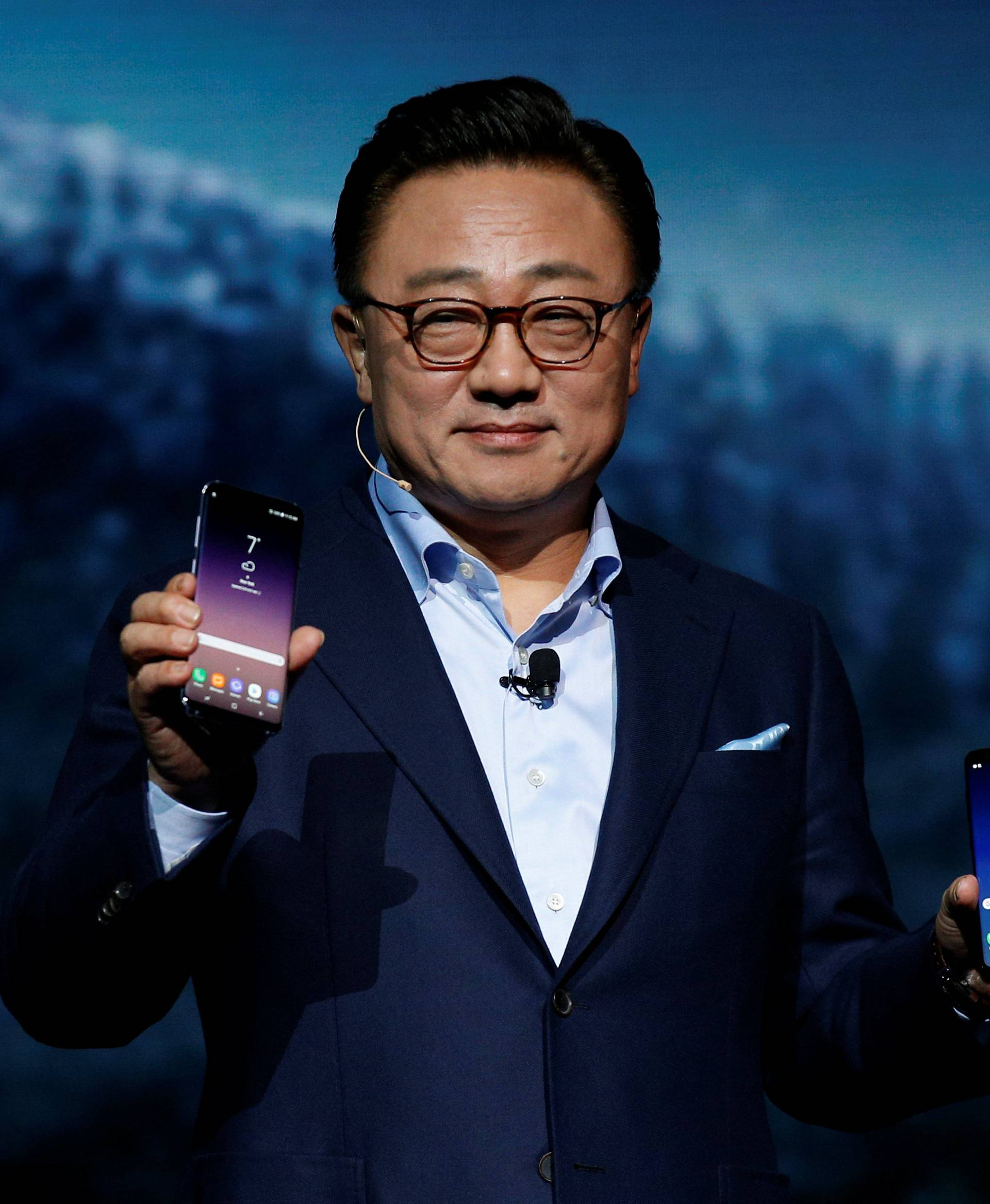 DJ Koh, Samsung president of mobile Communications, shows the Galaxy S8 and S8 + smartphones during the Samsung Unpacked event in New York
