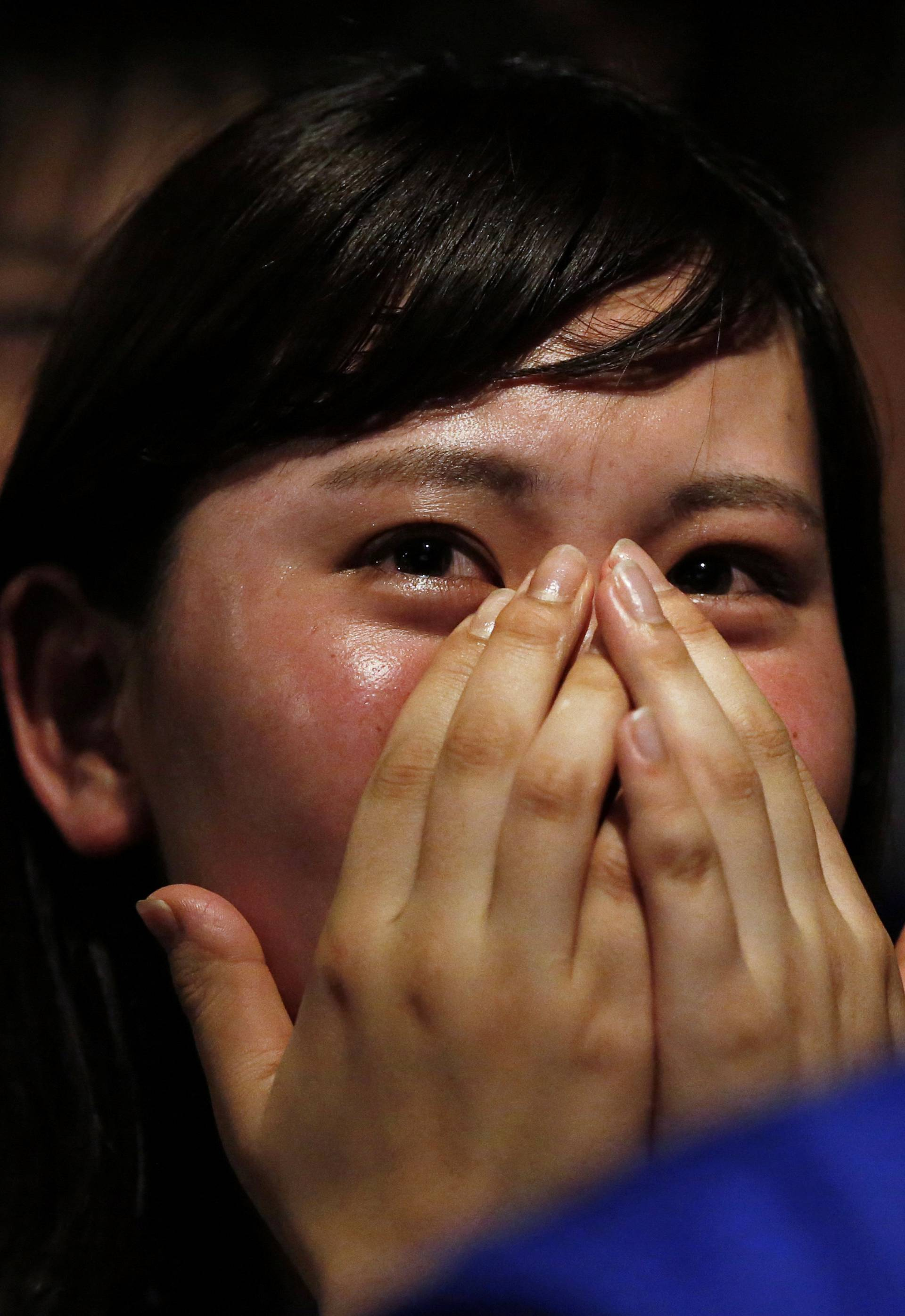 Japanese fans react as they watch a broadcast of the World Cup Round of 16 soccer match Belgium vs Japan in Tokyo