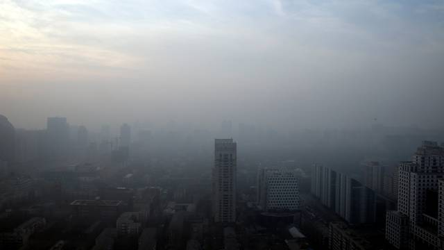 Buildings are seen in smog on a polluted day in Beijing