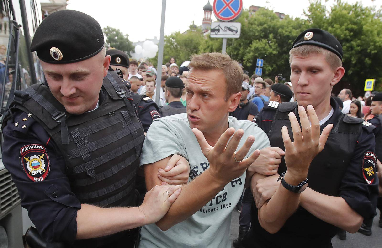 Policemen detain Russian opposition leader Navalny during a rally in support of investigative journalist Golunov in Moscow