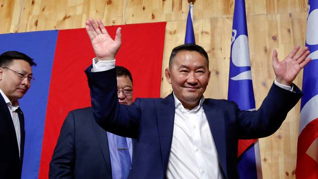 Khaltmaa Battulga, the presidential candidate of the opposition Democratic Party waves to reporters after addressing them in Ulaanbaatar