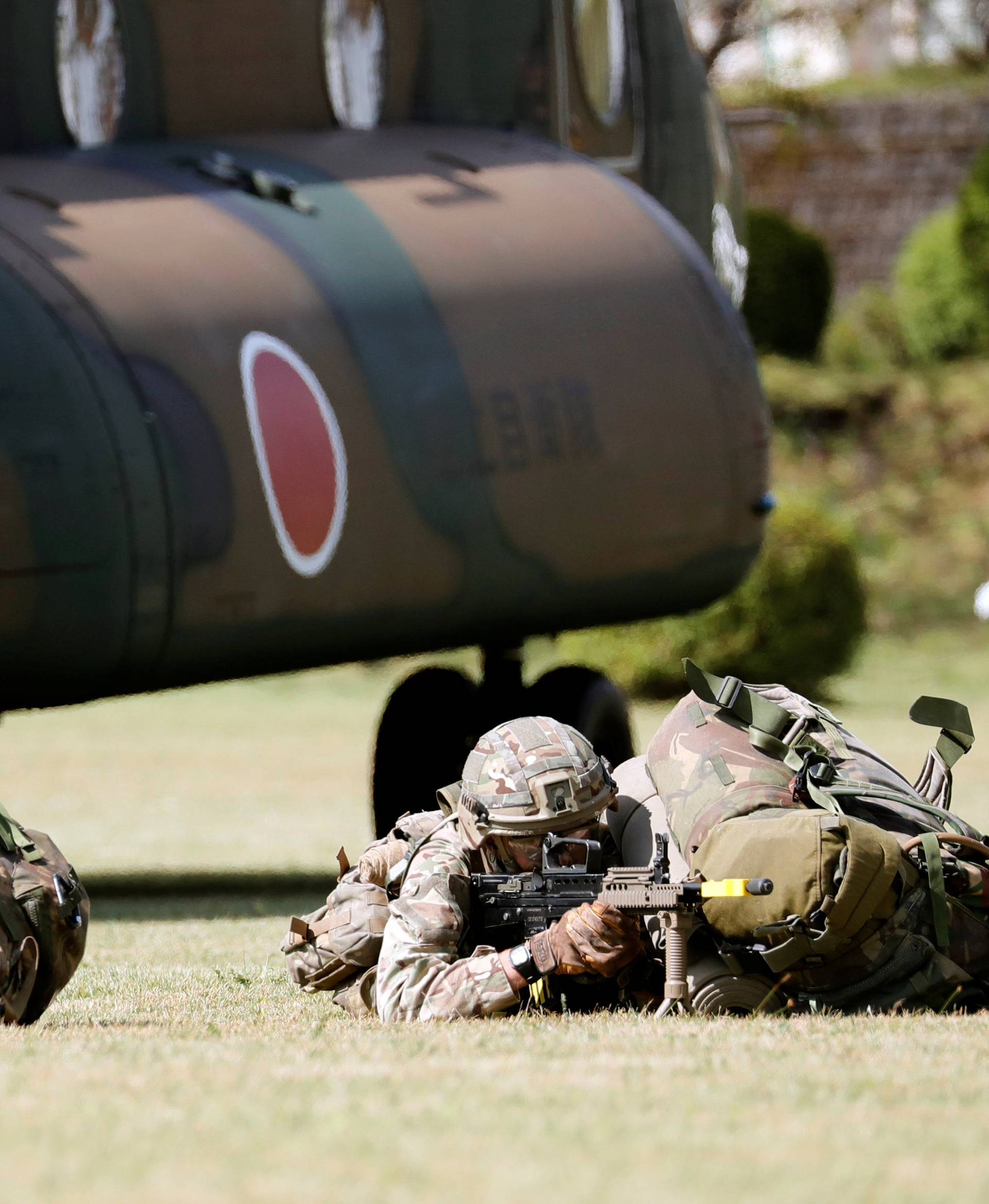 Members of the British Army take part in their first joint exercise with JGSDF at the JGSDF Camp Fuji in Oyama town