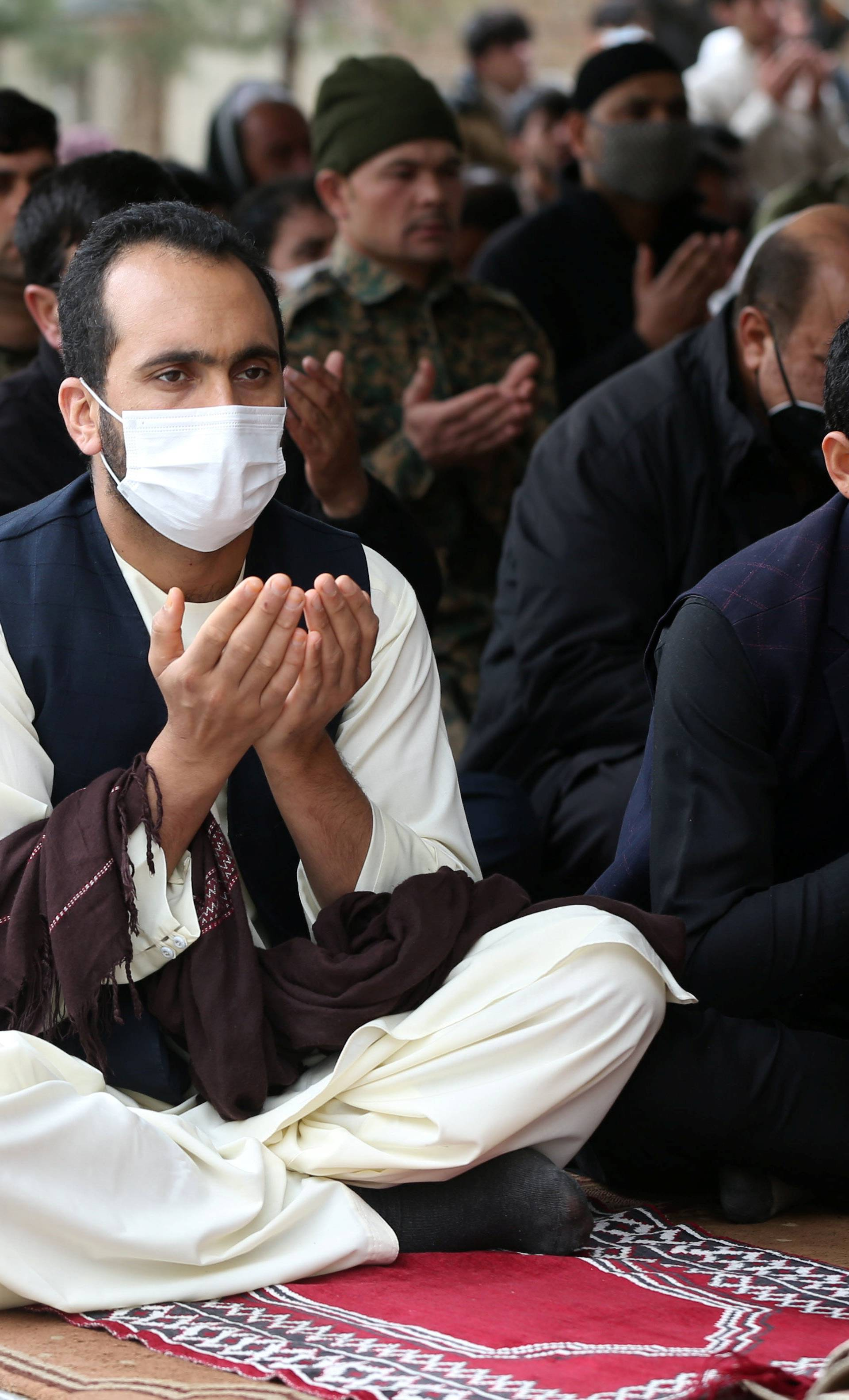 Muslims wearing protective masks attend Friday prayers at a mosque, amid concerns about the spread of coronavirus disease (COVID-19), in Kabul
