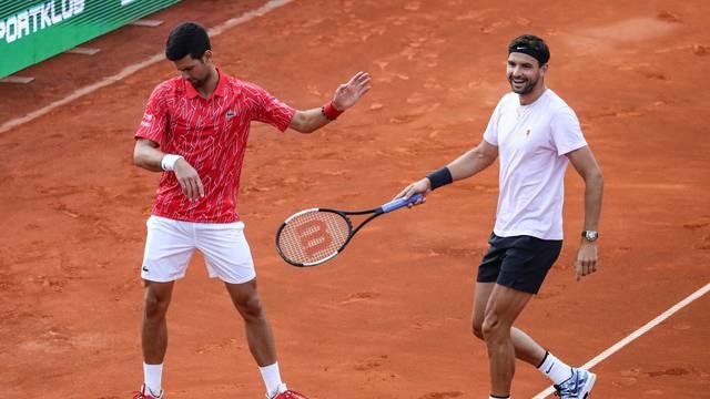 Serbia's Novak Djokovic with Bulgaria's Grigor Dimitrov during their doubles match during Adria Tour at Novak Tennis Centre in Belgrade