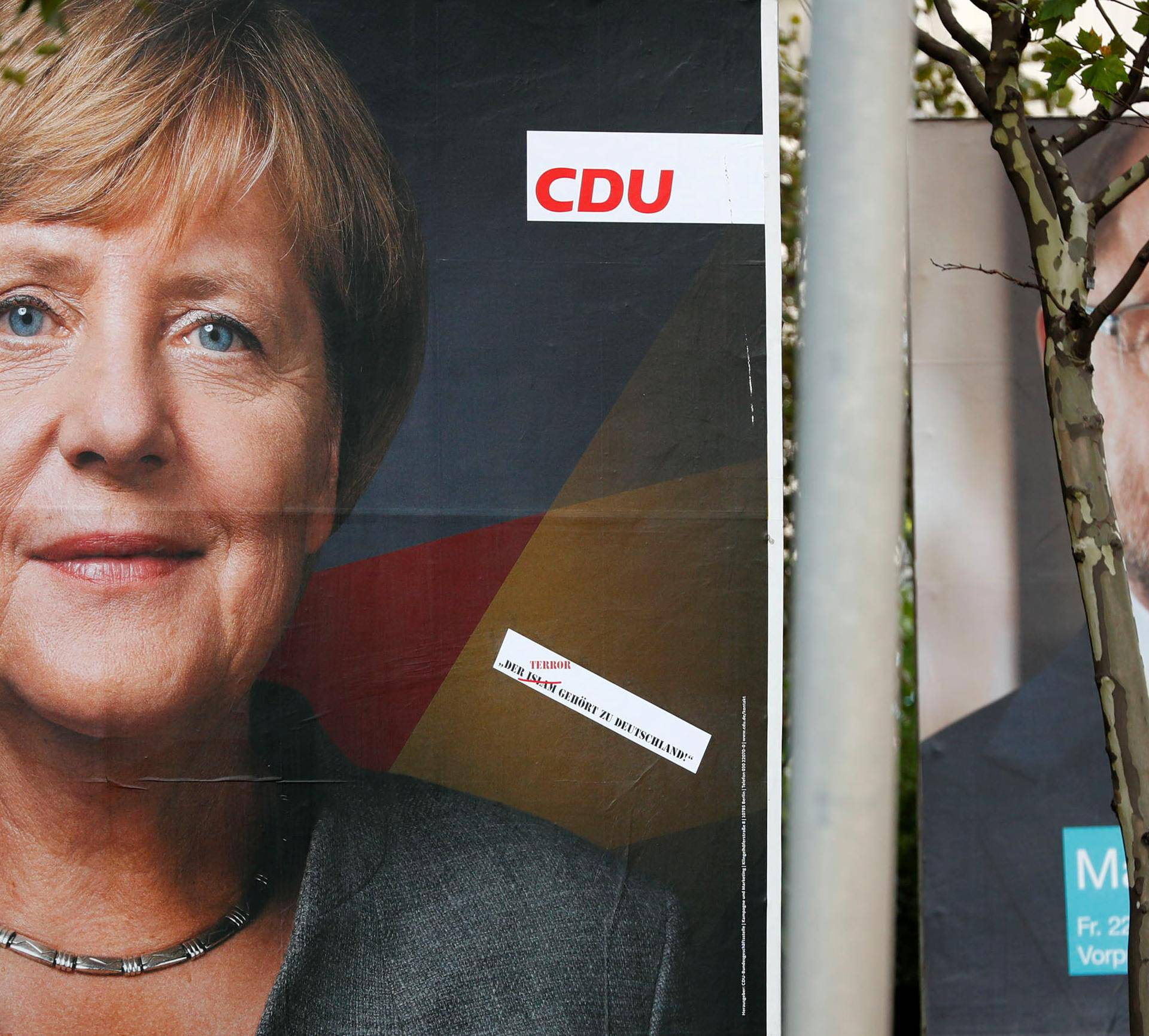 Election campaign posters of the CDU and SPD for the upcoming general elections are pictured in Berlin