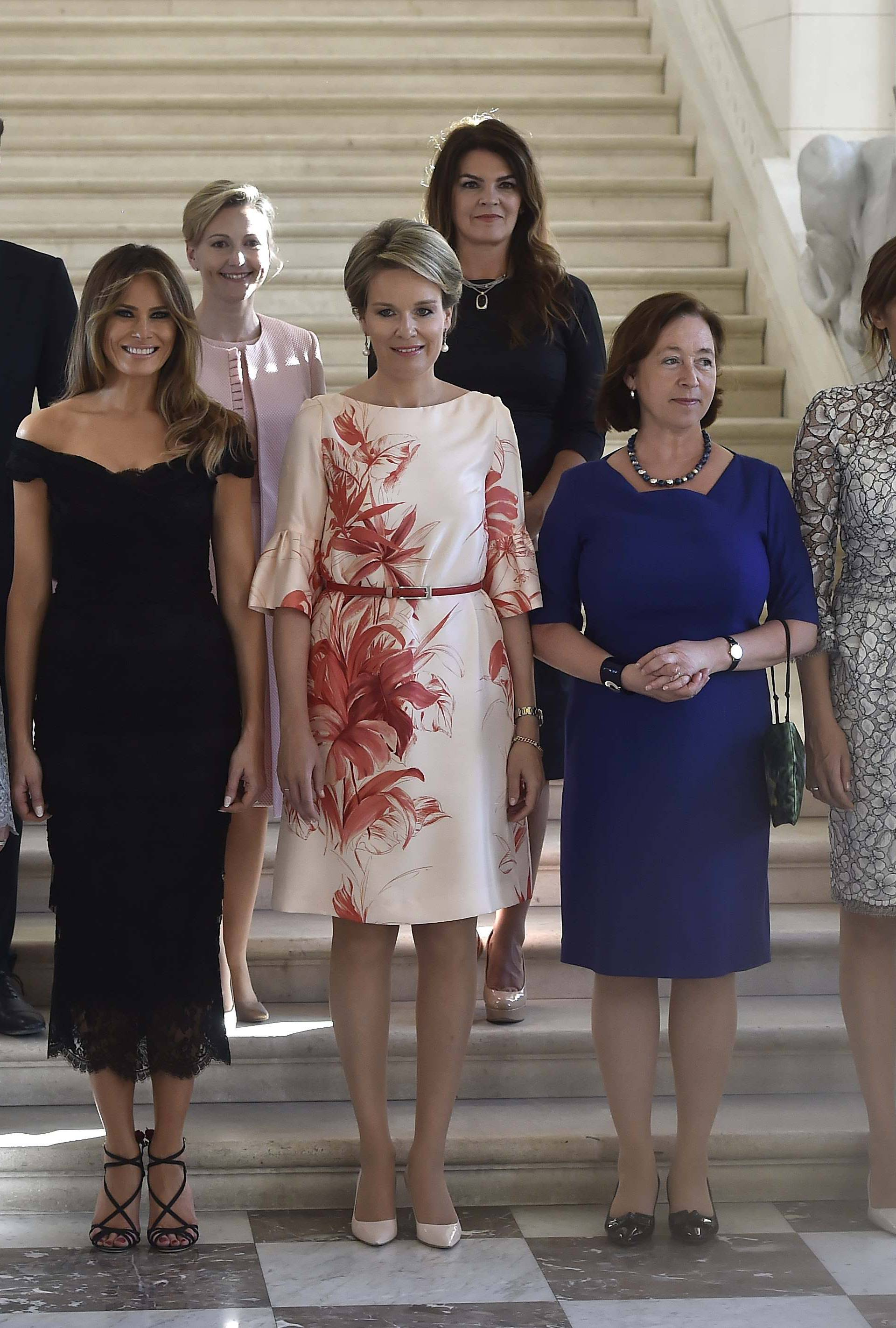 Queen Mathilde of Belgium poses for a group picture at the Royal Castle of Laeken in Brussels