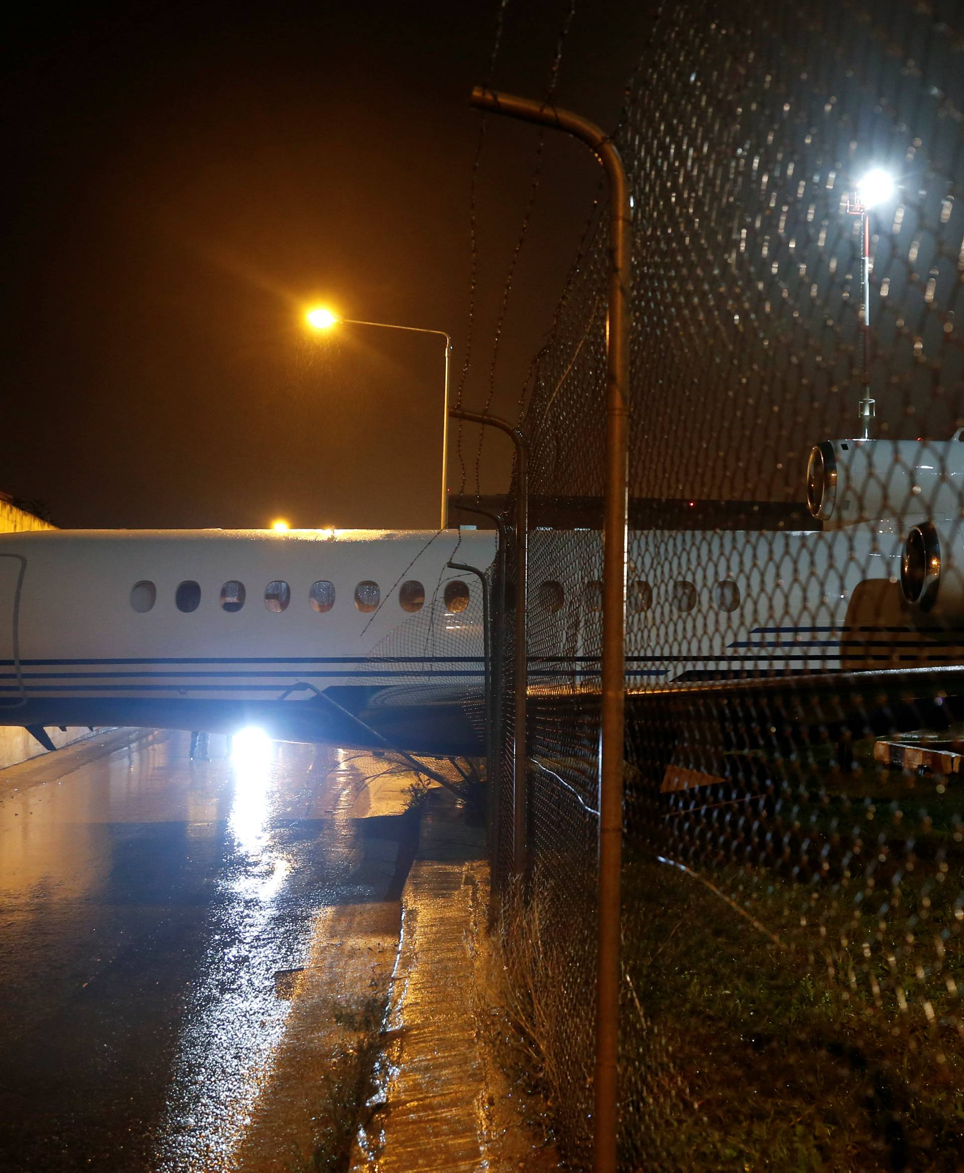 A privately-owned Dassault Falcon 7X business jet aircraft is seen after it was blown off the airport apron and into an adjacent building as strong winds hit the Maltese islands, at Malta International Airport in Luqa