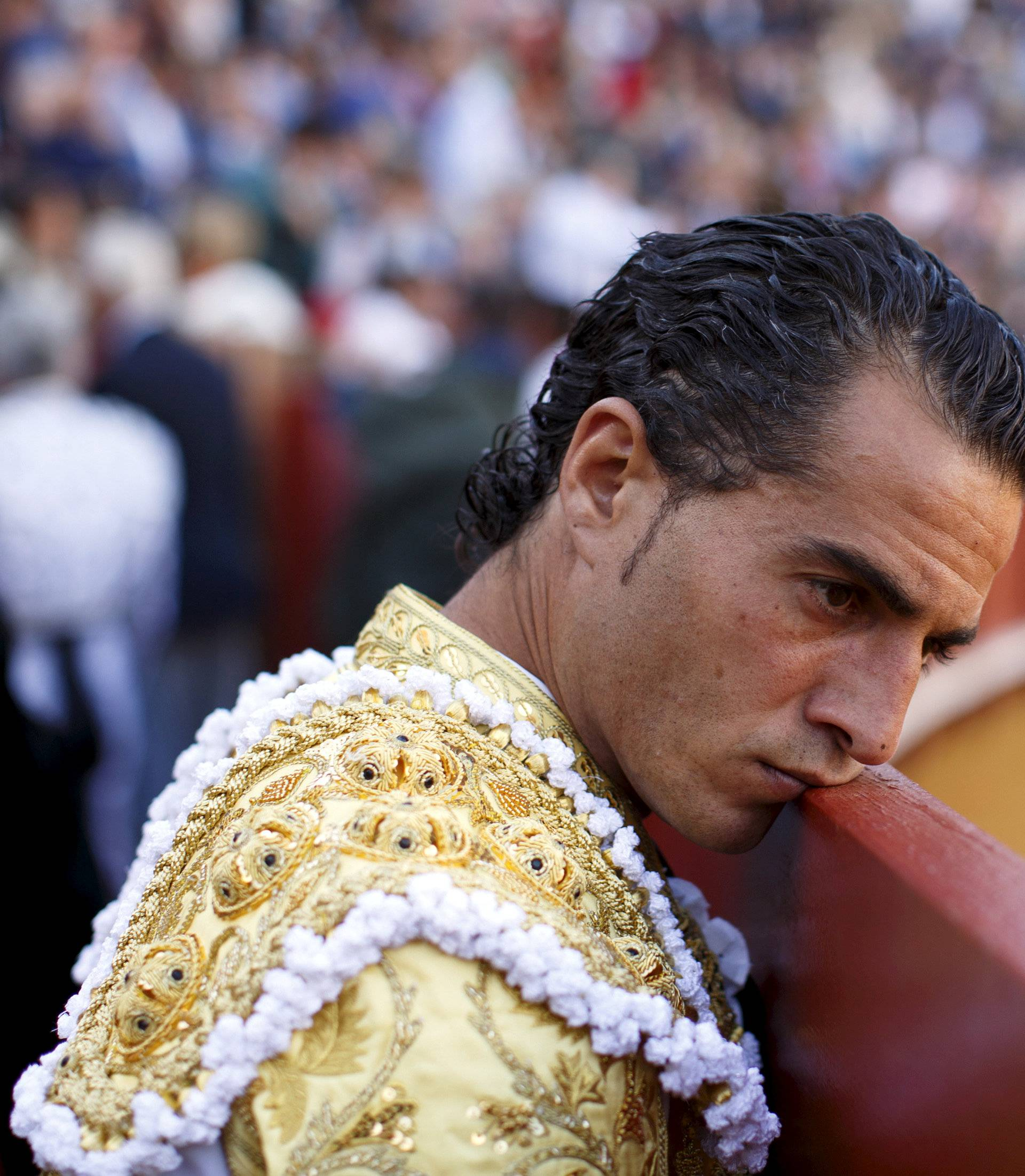 FILE PHOTO: Spanish matador Ivan Fandino leans his face on the barrier during a bullfight at the Maestranza bullring in the Andalusian capital of Seville