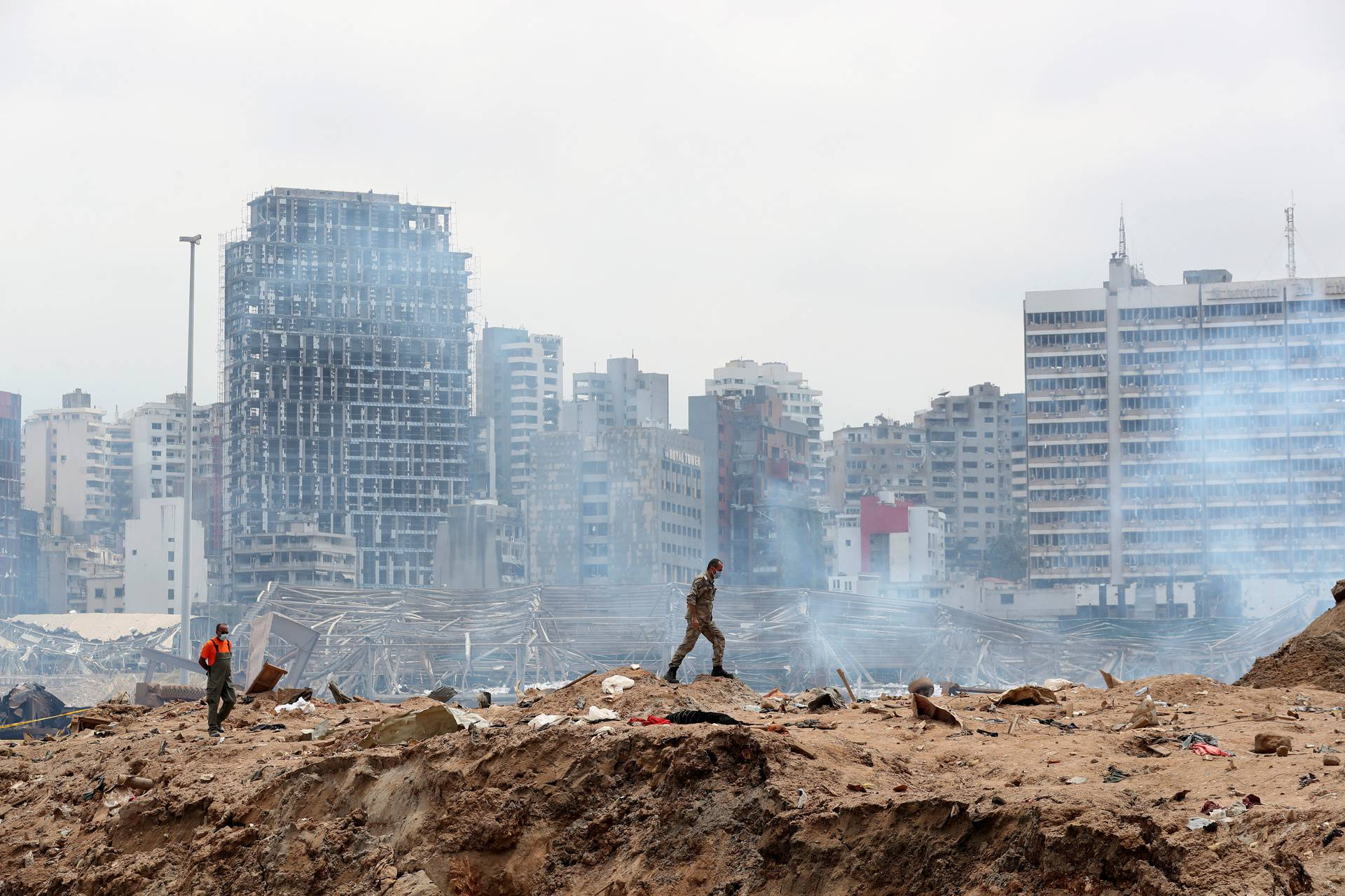 A soldier walks at the devastated site of the explosion at the port of Beirut