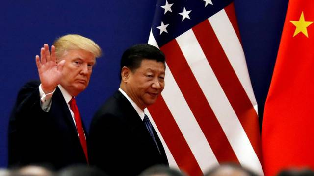 FILE PHOTO: FILE PHOTO: U.S. President Donald Trump and China's President Xi Jinping meet business leaders at the Great Hall of the People in Beijing